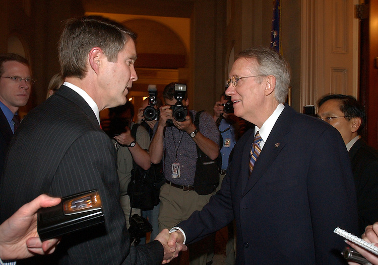 Senate Majority Leader Bill Frist, R-Tenn., left, talks with Senate Minority Leader Harry Reid, D-Nev., after both spoke on the floor about the compromise reached with the filibuster issue.