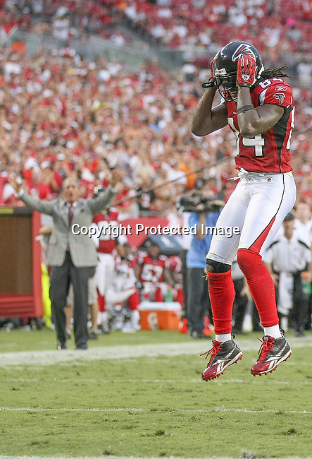 Atlanta Falcons wide receiver Roddy White (84) cannot believe he missed a touchdown pass reception as owner Arthur Blank waves in dismay in the background.  The Tampa Bay Buccaneers defeated the Falcons 16-13 in an NFL football game Sunday, Sept. 25, 2011 in Tampa, Fla. (AP Photo/Margaret Bowles)
