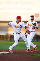 Springfield Cardinals shortstop Aledmys Diaz (16) throws to first as Bruce Caldwell (7) backs up the play during a game against the Frisco RoughRiders  on June 4, 2015 at Hammons Field in Springfield, Missouri.  Frisco defeated Springfield 8-7.  (Mike Janes/Four Seam Images)
