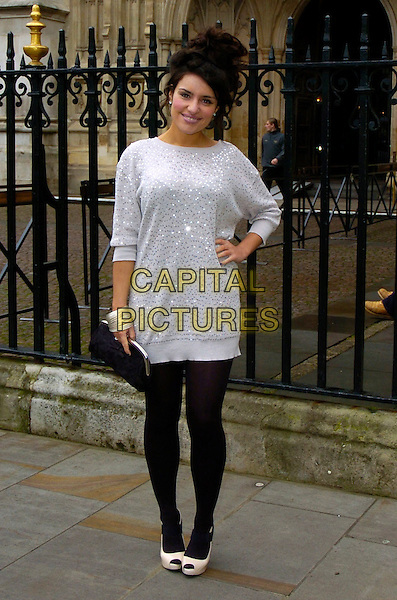 LAURA WHITE .X Factor's Laura White at The Woman's Own Children Of Courage Award, Westminster Abbey, London, England, UK, December 10th 2009..full length silver sequined sequin dress grey gray hair up hand on hip sweater jumper black tights bracelet cuff clutch bag white peep toe shoes cream .CAP/DYL.©Dylan/Capital Pictures.
