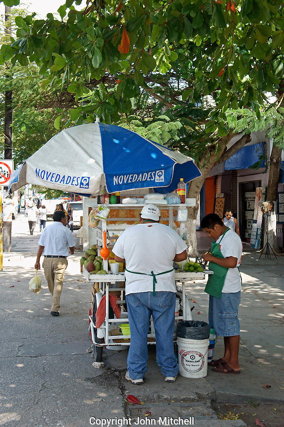 Father and son operated fruit stand on Avenida Tulum in downtown, Cancun, Quintana Roo, Mexico.