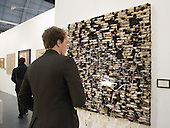 """27 February 2014, London, United Kingdom. Pictured: A man looks at the artwork """"Illuminated Ruin"""" by Hanaa Malallah. The Art14 Art Fair at Olympia Grand Hall, London, opens its doors to the public from 28 February to 2 March 2014. Art14 London features 180 galleries from 40 countries with works from emerging talents to modern masters."""