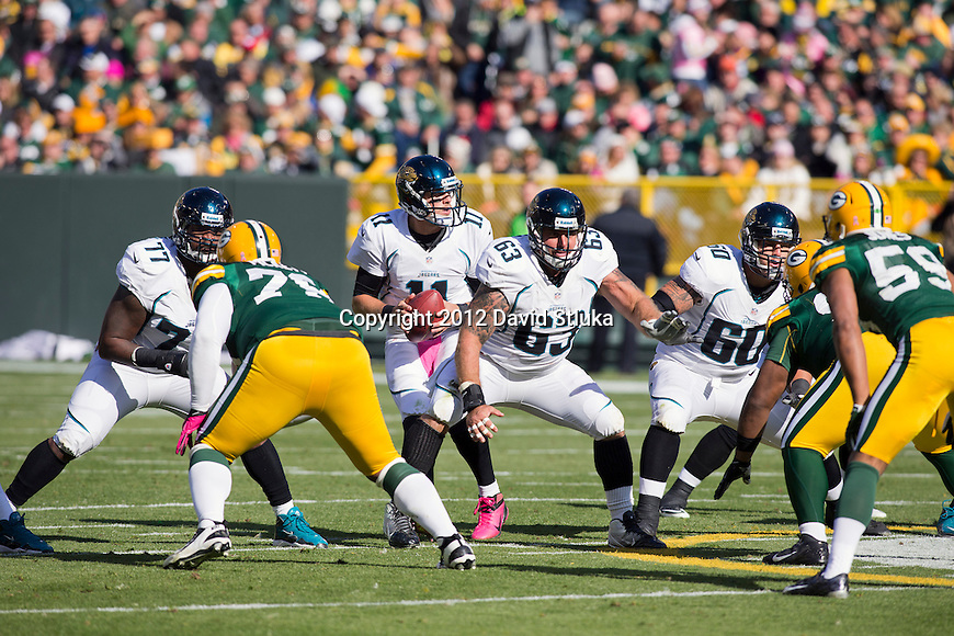 Jacksonville Jaguars offensive linemen Uche Nwaneri (77), Brad Meester (63) and Mike Brewster (60) pass block as quarterback Blaine Gabbert (11) drops back to pass during a week 8 NFL football game against the Green Bay Packers Sunday, October 28, 2012 in Green Bay, Wis. The Packers won 24-15. (AP Photo/David Stluka)