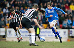 St Johnstone v Dunfermline....25.02.12   SPL.Murray Davidson drives at Paul Burns.Picture by Graeme Hart..Copyright Perthshire Picture Agency.Tel: 01738 623350  Mobile: 07990 594431