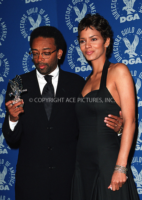 Spike Lee and Halle Berry at the 3rd Annual Directors Guild of America Awards. New York, June 9, 2002. Please byline: Alecsey Boldeskul/NY Photo Press.   ..*PAY-PER-USE*      ....NY Photo Press:  ..phone (646) 267-6913;   ..e-mail: info@nyphotopress.com