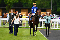 La Rav and Jamie Spencer are led into the winners enclosure after winning The Bathwick Tyres Maiden Stakes, during Afternoon Racing at Salisbury Racecourse on 13th June 2017