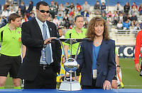 Washington Freedom General Manager Mark Washo (left) and Chairwoman and Owner of the Washington Freedom Maureen D. Hendrick (right) presenting the Founders Trophy at the beginning of the match.  Washington Freedom tied Chicago Red Stars 1-1  at The Maryland SoccerPlex, Saturday April 11, 2009.