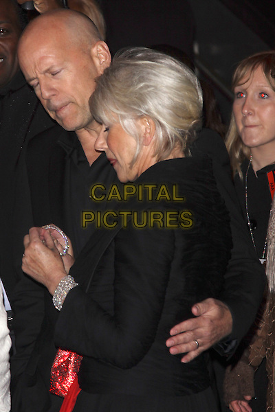 """BRUCE WILLIS & DAME HELEN MIRREN .""""Red"""" UK film premiere, Royal Festival Hall, Southbank Centre, London, England, UK, 19th October 2010. .half length holding earring diamante silver sparkly hoop arm around eyes shut side profile  .CAP/AH.©Adam Houghton/Capital Pictures."""