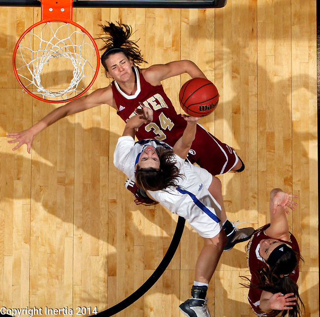 SIOUX FALLS, SD - MARCH 9:  Amanda Hyde #11 from IPFW takes the ball to the basket against Theresa Wirth #34 from Denver in the second half of their game Sunday afternoon at the 2014 Summit League Basketball Tournament in Sioux Falls, SD. (Photo by Dave Eggen/Inertia)