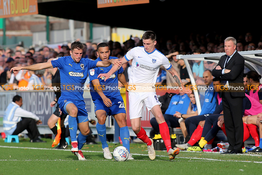 AFC Wimbledpn's Ben Purrington  and Oliver Hawkins of Portsmouth challenge for the ball during AFC Wimbledon vs Portsmouth, Sky Bet EFL League 1 Football at the Cherry Red Records Stadium on 13th October 2018