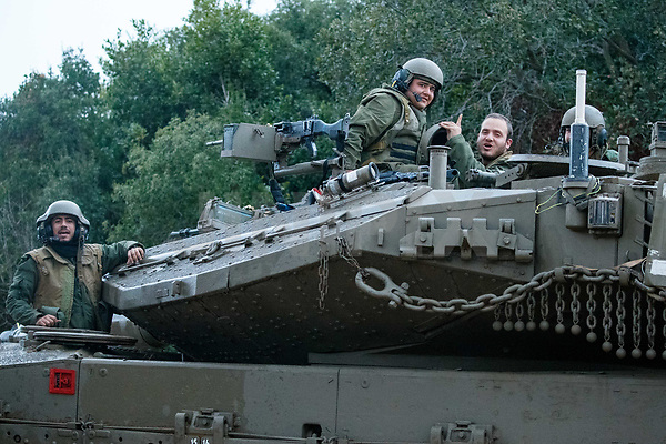 A picture taken on December 5, 2018, near the Israeli town of Zarit, shows an Israeli  soldiers atop of Israeli Merkava tank parked near the border with Lebanon, after the area was declared a closed military zone by the Israeli army. - Israel's army said earlier in the week that it has discovered Hezbollah tunnels infiltrating its territory from Lebanon and launched an operation to destroy them, a move likely to raise tensions with the Iran-backed group. Photo by: JINIPIX
