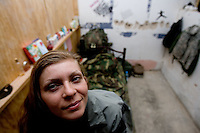 """Private First Class  Jennifer Baker, 26 years old from Esperia California and with Echo Company, 1st Battalion, 506th, 101st airborne Division in her room at Combat Outpost ( C.O.P) in Eastern Ramadi, Al Anbar Province, Iraq on Sunday JAN 28 2006. this is her second year in the military. she has not yet decided if she will reenlist. she says about the ARMY: """" I feel that the military has made me a very strong individual and I will never let myself down"""""""