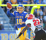 BROOKINGS, SD - OCTOBER 25:  Zach Lujan #16 from South Dakota State University llooks for a receiver as Duben Nwadiogbu #22 from Youngstown State applies pressure in the first quarter of their game Saturday afternoon at Coughlin Alumni Stadium in Brookings. (Photo by Dave Eggen/Inertia)