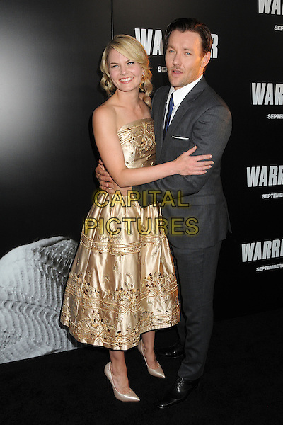 "Jennifer Morrison & Joel Edgerton.""Warrior"" World Premiere held at Arclight Cinemas, Hollywood, California, USA..September 6th, 2011.full length gold dress strapless embroidered hug embrace grey gray suit.CAP/ADM/BP.©Byron Purvis/AdMedia/Capital Pictures."