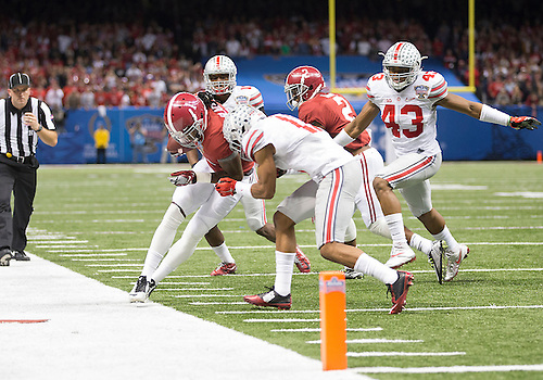 January 02, 2015:  Alabama wide receiver Chris Black (1) runs with the ball as Ohio State defensive back Vonn Bell (11) defends during NCAA Football game action between the Ohio State Buckeyes and the Alabama Crimson Tide at Mercedes-Benz Superdome in New Orleans, Louisiana.  Ohio State defeated Alabama 42-35.