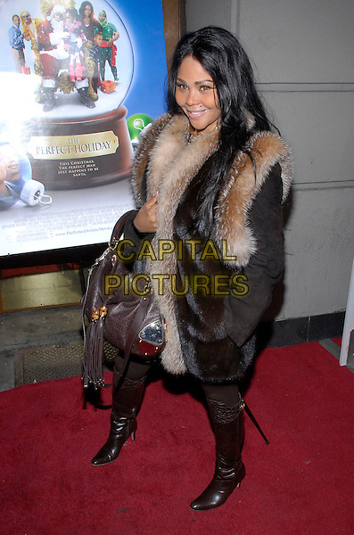 "LIL' KIM.The stars come out to party and celebrate ""The Perfect Holiday""  at Marquee, New York, New York, USA,.10 December 2007..full length fur scarf bag boots.CAP/ADM/BL.©Bill Lyons/AdMedia/Capital Pictures. *** Local Caption ***"