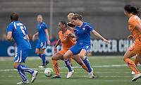 Sky Blue FC midfielder Rosana (11) controls the ball as Boston Breakers defender Jordan Angeli (4) defends. Sky Blue FC defeated the Boston Breakers, 2-1, at Harvard Stadium on June 13, 2010.
