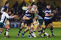 Teimana Harrison of Northampton Saints offloads the ball after being tackled. Aviva Premiership match, between Bath Rugby and Northampton Saints on February 10, 2017 at the Recreation Ground in Bath, England. Photo by: Patrick Khachfe / Onside Images