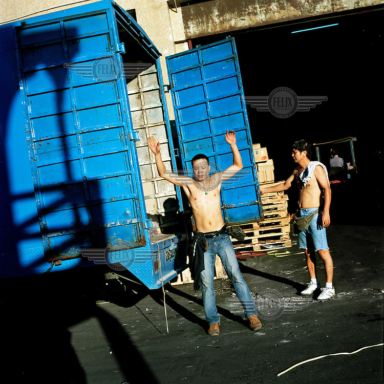 Workers unloading a truck.