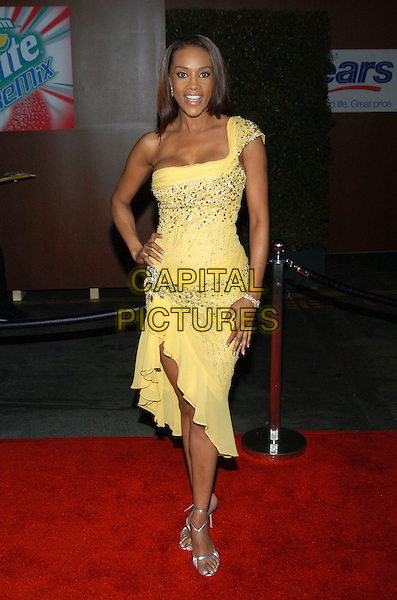 VIVICA A. FOX.19th Annual Soul Train Music Awards held at the Paramount Studios. Hollywood, California.Photo Credit: Jacqui Wong/AdMedia//Sipa Press.February 28th, 2005.full length yellow sequined dress silver strappy sandals one shoudler off the shoulder hand on hip.www.capitalpictures.com.sales@capitalpictures.com.© Capital Pictures.