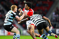 Picture by Alex Whitehead/SWpix.com - 01/05/2014 - Rugby League - First Utility Super League - St Helens v London Broncos - Langtree Park, St Helens, England - St Helens' Mose Masoe is tackled by London's James Cunningham and Jon Wallace.