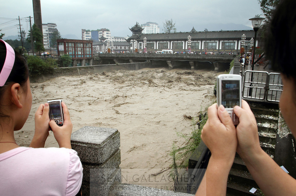 "Flood waters during the summer are channeled though the Dujiangyan Irrigation System. The system is regarded as an ""ancient Chinese engineering marvel."" By naturally channeling water from the Min River during times of flood, the irrigation system served to protect the local area from flooding and provide water to the Chengdu basin. Sichuan Province. 2010"