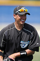 Toronto Blue Jays minor league second baseman Ryan Goins warms up before a game vs the New York Yankees at the Englebert Minor League Complex in Dunedin, Florida;  March 21, 2011.  Photo By Mike Janes/Four Seam Images
