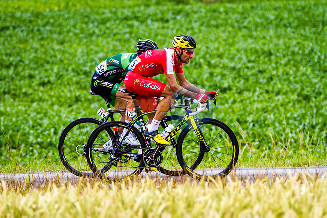 The breakaway Thomas Voeckler (FRA) Team Europcar and Luis Angel Mate Mardones (ESP) Cofidis pass through rural landscape near Bemont during Stage 4 of the 2014 Tour de France running 163.5km from Le Touquet to Lille. 8th July 2014.<br /> Picture:Thomas van Bracht/Peloton Photos/www.newsfile.ie