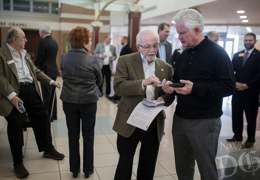 NWA Democrat-Gazette/CHARLIE KAIJO Keith Gibson and outgoing Arkansas Highway Commission Chair Dick Trammel (from right) talk to each other during a ribbon cutting, January 4, 2019 at the Jones Center in Springdale. <br /><br />State highway and local officials held a ribbon cutting to mark the opening of a new section of Arkansas 265 that will carry traffic on the north-south corridor into downtown Rogers.