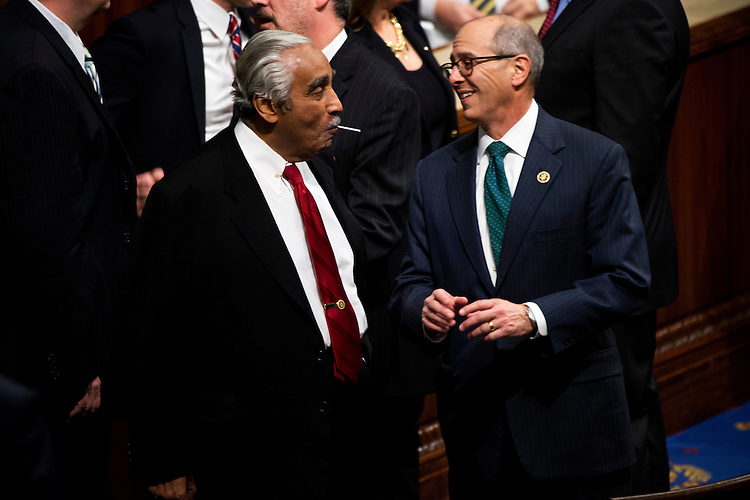 UNITED STATES - JANUARY 20: Reps. Charlie Rangel, D-N.Y, left, and Charles Boustany, R-La., talk in the Capitol's House chamber before President Barack Obama's State of the Union address, January 20, 2015. (Photo By Tom Williams/CQ Roll Call)