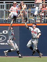 Maryland outfielder Charlie White (4), right, catches the ball before bumping into teammate Tim Lewis (39), left, in the fifth inning of an NCAA college baseball tournament super regional game against Maryland in Charlottesville, Va., Saturday, June 7, 2014. Maryland defeated Virginia 5-4. (AP Photo/Andrew Shurtleff)