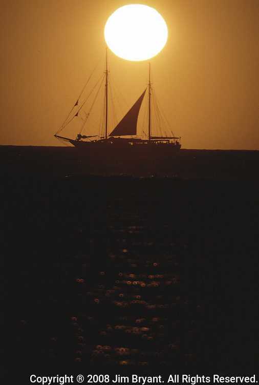 Silhouetted by the sunset a cruise boat cruises the Pacific Ocean off the Island of Honolulu, Hawaii. (Jim Bryant Photo).....