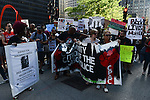 Chicago Police torture victim Mark Clements (at center) and mother of another, Bertha Escamilla (front right) lead a march from Federal Plaza to support a Citizens Police Accountability Council to provide civilian oversight of the Chicago Police Department in Chicago, Illinois on July 11, 2016.  The demonstration attracted a larger crowd on the heels of last week's racially charged police shootings captured on video of Alton Sterling in Baton Rouge, Louisiana and Philando Castile in the St. Paul suburb of Falcon Heights, Minnesota which was followed by a mass shooting of five police officers by Afghan War veteran Micah Johnson who supported radical and violent black nationalist ideology.