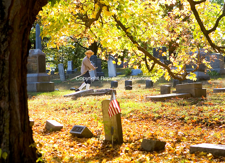 NAUGATUCK, CT- 13 OCT 06- 101306JT01- <br /> Alex Crean, 12, walks through Hillside Cemetery in Naugatuck dressed up as local historical figure Chauncey Judd, a young man kidnapped by Tories during the Revolutionary War, on Friday afternoon before a cemetery walk held by the Naugatuck Historical Society to talk about the life and times of the prominent citizens of Naugatuck. A walk will also be held on Saturday, beginning at Linden Park, from 4 p.m. to 6 p.m.