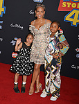 "Christina Milian and kids 034 arrives at the premiere of Disney and Pixar's ""Toy Story 4"" on June 11, 2019 in Los Angeles, California."