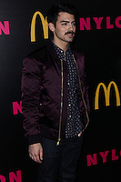 WEST HOLLYWOOD, CA - DECEMBER 05: Joe Jonas arrives at the Nylon Magazine December 2013/January 2014 Cover Launch Party held at Quixote Studios on December 5, 2013 in West Hollywood, California. (Photo by Xavier Collin/Celebrity Monitor)