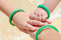 Three sisters hands unite with matching jade bracelets