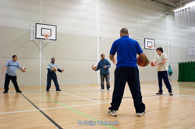 Basketball training at the Monday Night Club, a sports session at Talacre Sports Centre, Camden, for adults with physical or learning disabilities.