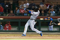 Surprise Saguaros left fielder Julio Pablo Martinez (40), of the Texas Rangers organization, swings at a pitch during an Arizona Fall League game against the Scottsdale Scorpions at Scottsdale Stadium on October 15, 2018 in Scottsdale, Arizona. Surprise defeated Scottsdale 2-0. (Zachary Lucy/Four Seam Images)