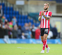 Lincoln City's Jorge Grant applauds the fans at the final whistle<br /> <br /> Photographer Andrew Vaughan/CameraSport<br /> <br /> The EFL Sky Bet League One - Wycombe Wanderers v Lincoln City - Saturday 7th September 2019 - Adams Park - Wycombe<br /> <br /> World Copyright © 2019 CameraSport. All rights reserved. 43 Linden Ave. Countesthorpe. Leicester. England. LE8 5PG - Tel: +44 (0) 116 277 4147 - admin@camerasport.com - www.camerasport.com
