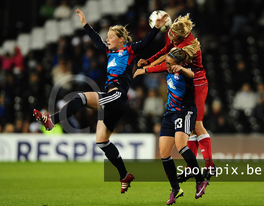 Uefa Women 's Champions League Final 2011 at Craven Cottage Fulham - London : Olympique Lyon - Turbine Potsdam : luchtduel tussen Amandine Henry , Camille Abily  en Viola Odebrecht..foto DAVID CATRY / JOKE VUYLSTEKE / Vrouwenteam.be.