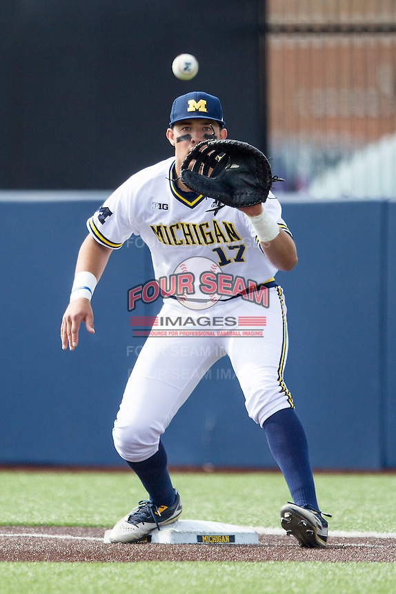 Michigan Wolverines first baseman Drew Lugbauer (17) records an out against the Toledo Rockets on April 20, 2016 at Ray Fisher Stadium in Ann Arbor, Michigan. Michigan defeated Bowling Green 2-1. (Andrew Woolley/Four Seam Images)