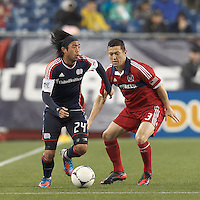 New England Revolution midfielder Lee Nguyen (24) dribbles as Chicago Fire defender Dan Gargan (3) defends. In a Major League Soccer (MLS) match, the New England Revolution defeated Chicago Fire, 2-0, at Gillette Stadium on June 2, 2012.