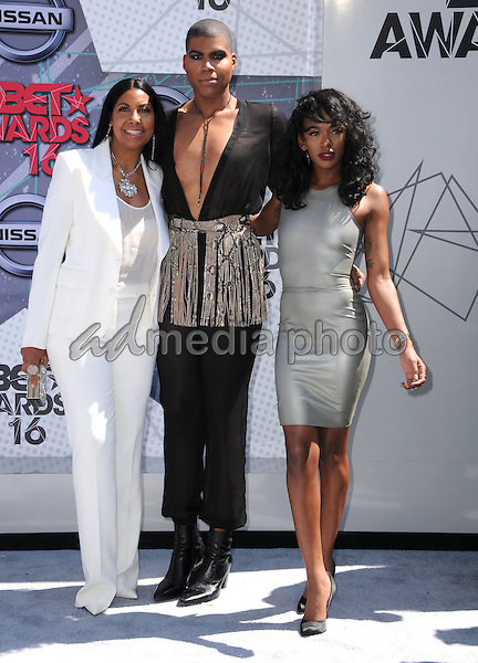 26 June 2016 - Los Angeles. Cookie Johnson, EJ Johnson, Elisa Johnson. Arrivals for the 2016 BET Awards held at the Microsoft Theater. Photo Credit: Birdie Thompson/AdMedia