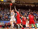 BROOKINGS, SD - DECEMBER 3: Tagyn Larson #24 from South Dakota State takes the ball to the basket past Kylee Shook #21 from Louisville during their game Sunday afternoon at Frost Arena in Brookings, SD.  (Photo by Dave Eggen/Inertia)