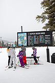 USA, Colorado, Aspen, skiers look at a trail map at Highlands Ski Resort