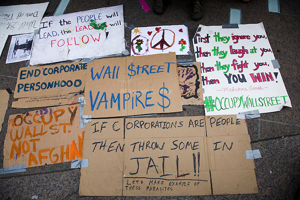 Signs are placed along the ground as protesters continue to gather in Liberty Square in lower Manhattan in New York on  30 September 2011, day 13 of Occupy Wall Street, a resistance movement targeting corporate greed and corruption.
