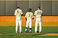 \wf5, Joey Rodriguez (7) and Jack Carey (20) during the National Anthem prior to the game against the North Carolina State Wolfpack at Wake Forest Baseball Park on March 15, 2013 in Winston-Salem, North Carolina.  The Wolfpack defeated the Demon Deacons 12-6.  (Brian Westerholt/Four Seam Images)
