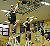 Isabella Fallon, left, and he Ward Melville varsity cheerleading squad perform during an eight-team competition held at Bethpage High School on Sunday, Jan. 22, 2017.