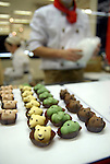 """A pastry chef makes chocolates at Nihonbashi Takashimaya's chocolate fair """"Amour du Chocolat!"""" for Valentine's Day in Tokyo."""